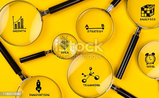 Business planning. Magnifiers on yellow background.