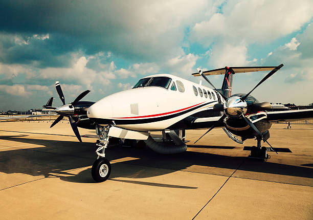 Business plane A small private business jet parked on an airport propeller stock pictures, royalty-free photos & images