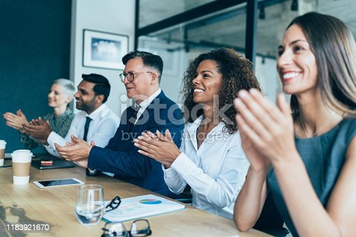 Business people clapping hands during Business presentation at the office