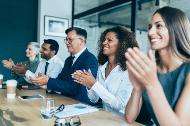 Business presentation Business people clapping hands during Business presentation at the office staff meeting stock pictures, royalty-free photos & images