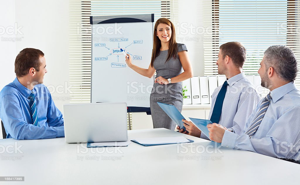 Business presentation Business team having a brainstorming in a boardroom, discussing new strategy of their company. Adult Stock Photo