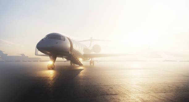 Business-Privatjet-Flugzeug am Terminal in Sonnenaufgang geparkt. Luxustourismus und Business-Reise-Transport-Konzept. 3D-Rendering. – Foto