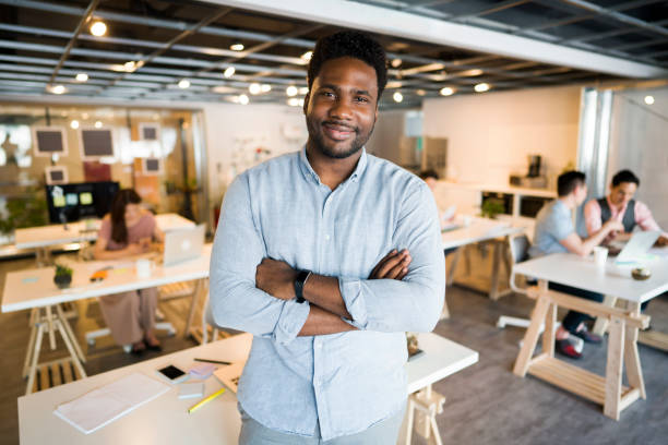 Business Pro Portrait of an African ethnicity businessman standing proudly at his office. project manager stock pictures, royalty-free photos & images
