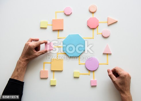 istock Business Process Concept Shapes Paper 639819378