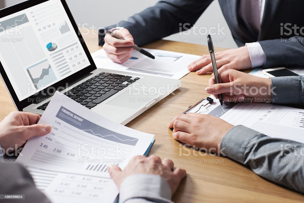 Business professionals analyzing financial data stock photo