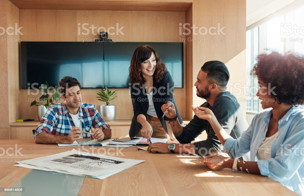 Business professionals having a meeting in boardroom stock photo