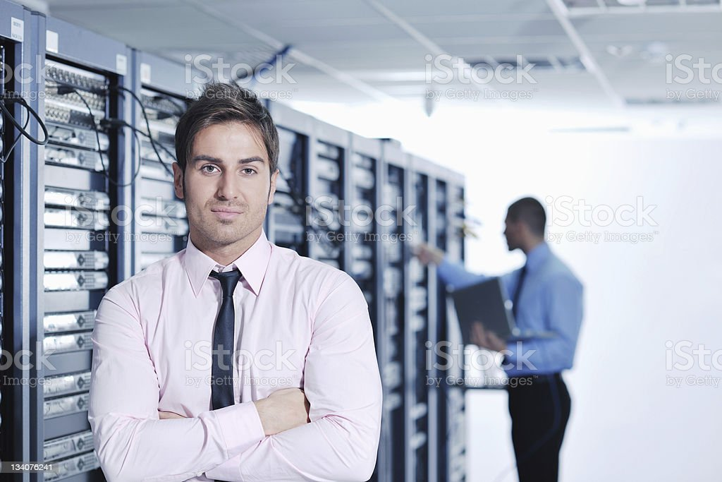 Business professionals in IT network server room royalty-free stock photo