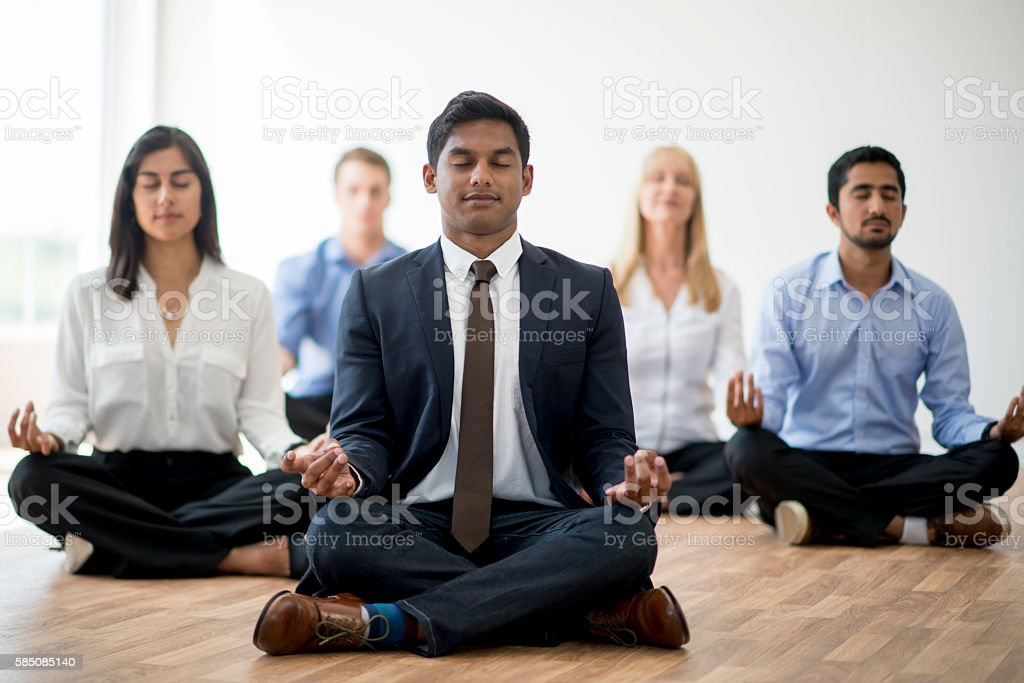 Business Professionals Meditating Together stock photo