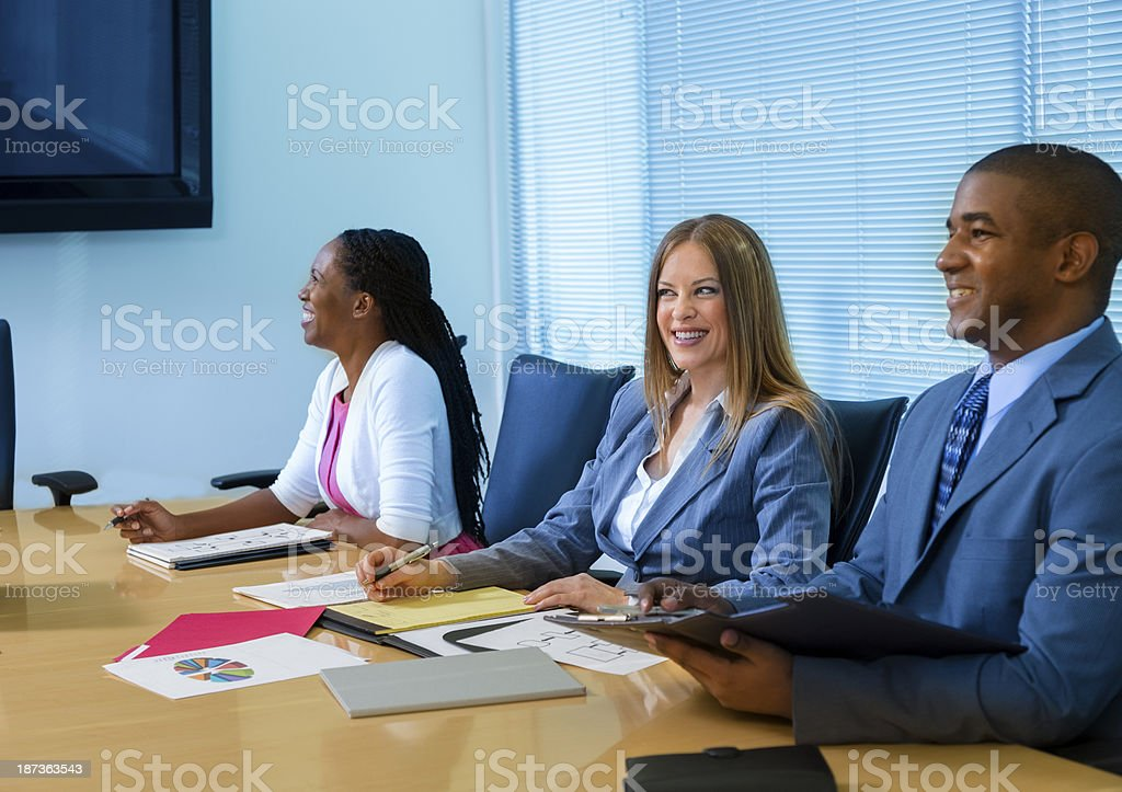 Business:  Professionals share data during office meeting. royalty-free stock photo