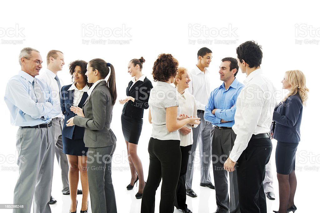 Business professionals standing together visiting stock photo