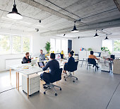 istock Business professionals working at new office desk 1271153817