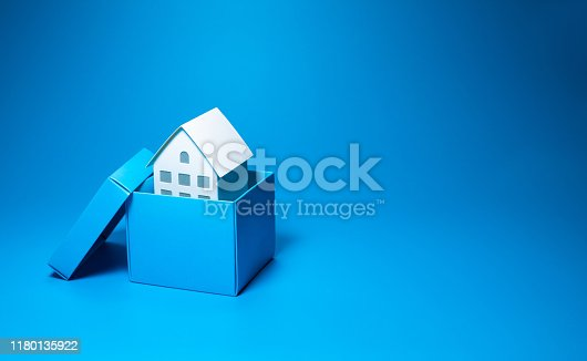 istock Business property and real estate concepts with white model house inside small box over all on pastel color 1180135922