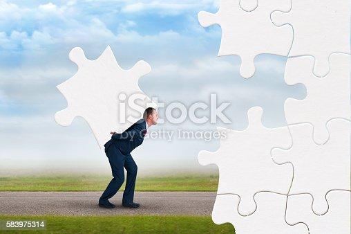 business puzzle concept businessman faces adversity to solve jigsaw