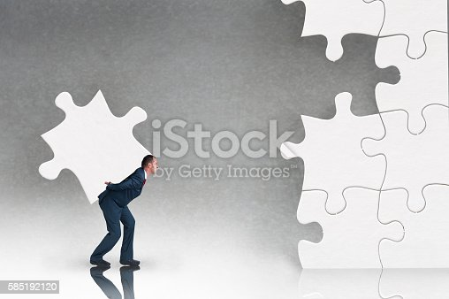 business puzzle concept businessman working to complete a jigsaw