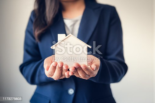 Business Real Estate and Residential Investment Concept, Broker Sell Agency Advisor of Property Estates Handover New Housing to Customers While Holding House Model. Business Financial/Investing