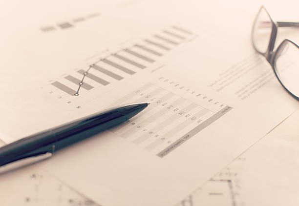 Business report and charts stock photo