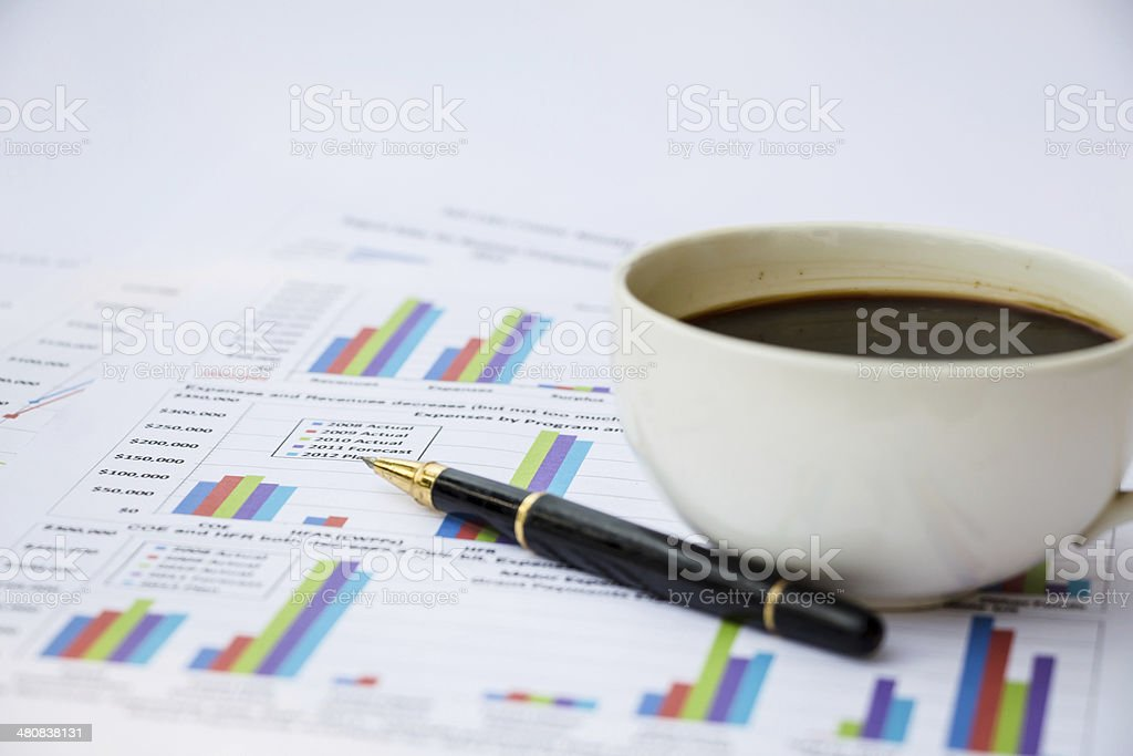 Business report. Cup of coffee on document. royalty-free stock photo