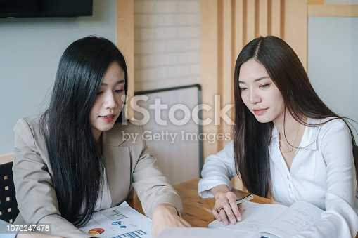 1032388356 istock photo Business research, economic, budget concept, Supervisor discussing henchman to meeting for business graph chart strategy and finance plan in office. casual concept. 1070247478