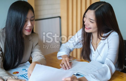 1032388356 istock photo Business research, economic, budget concept, Supervisor discussing henchman to meeting for business graph chart strategy and finance plan in office. casual concept. 1070247620