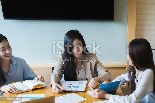 1032388356 istock photo Business research, economic, budget concept, Supervisor discussing henchman to meeting for business graph chart strategy and finance plan in office. casual concept. 1070247640