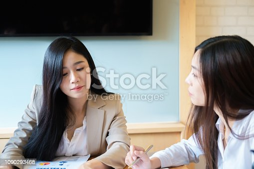 1032388356 istock photo Business research, economic, budget concept, Supervisor discussing henchman to meeting for business graph chart strategy and finance plan in office. casual concept. 1090293468