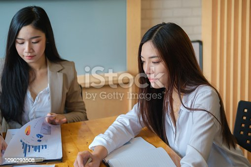 1032388356 istock photo Business research, economic, budget concept, Supervisor discussing henchman to meeting for business graph chart strategy and finance plan in office. casual concept. 1090293508