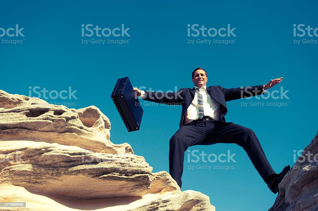 Business risk concept. Businessman on a mountain top royalty-free stock photo