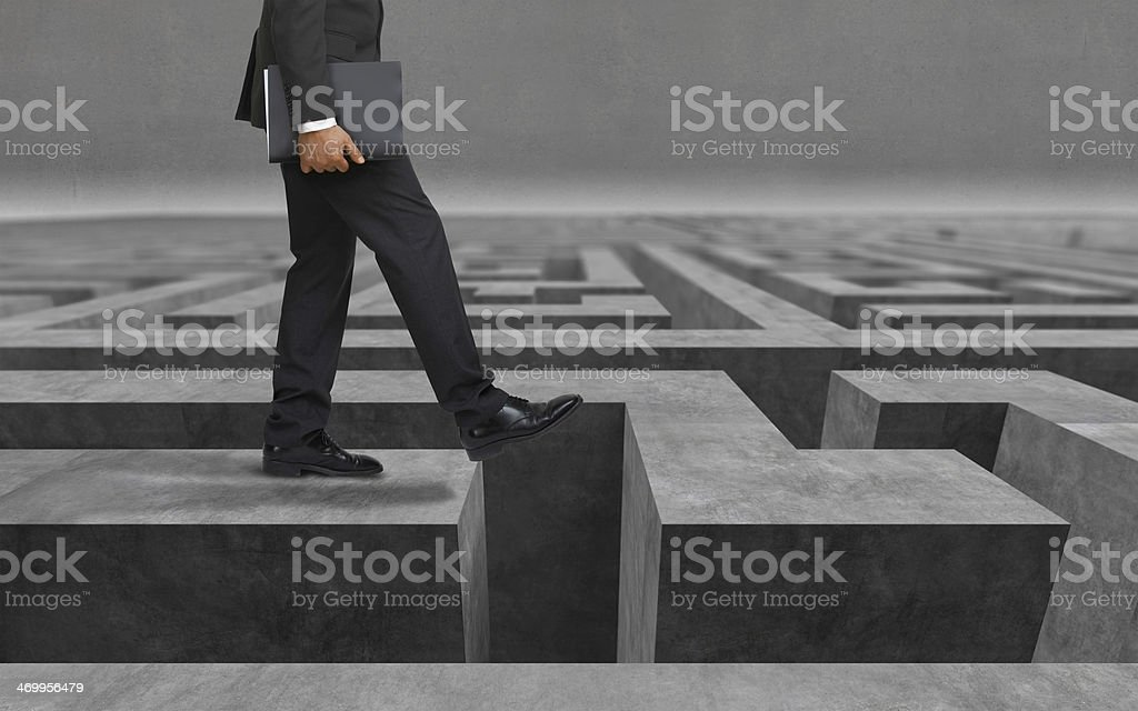 Business risk, problems, dangers: businessman stepping into unknow, falling down? stock photo