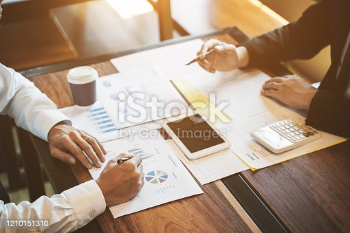 1068752548 istock photo Business sales consultant discussing in data documents at modern office. 1210151310