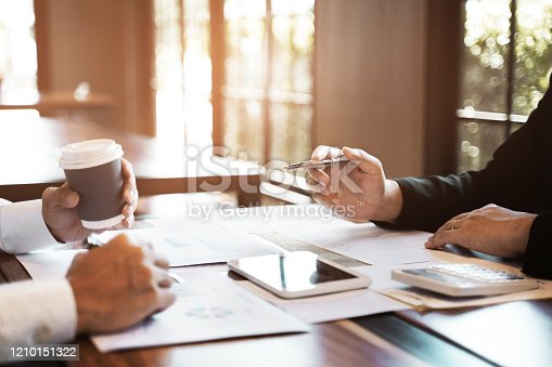 1068752548 istock photo Business sales consultant discussing in data documents at modern office. 1210151322