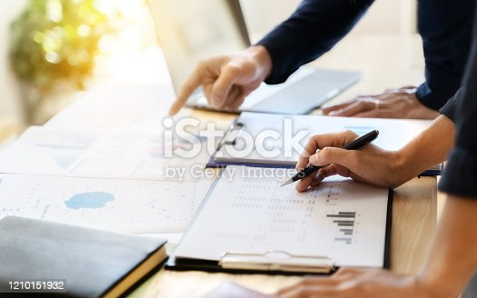 1068752548 istock photo Business sales consultant discussing in data documents at modern office. 1210151932