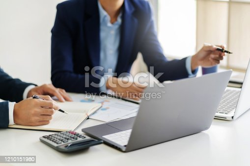 1068752548 istock photo Business sales consultant discussing in data documents at modern office. 1210151980