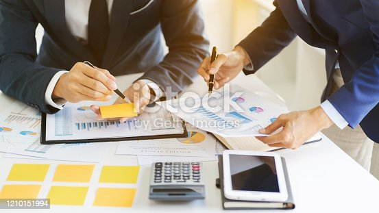 1068752548 istock photo Business sales consultant discussing in data documents at modern office. 1210151994