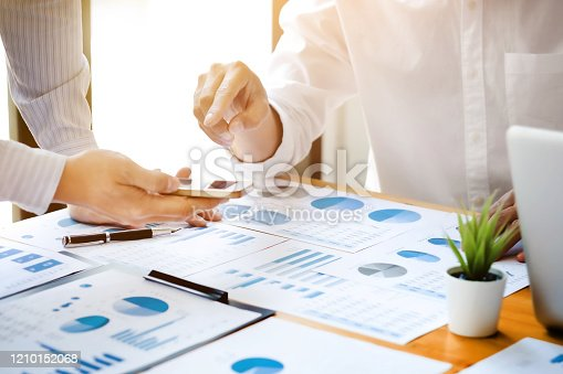 1068752548 istock photo Business sales consultant discussing in data documents at modern office. 1210152068