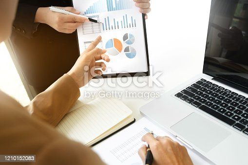 1068752548 istock photo Business sales consultant discussing in data documents at modern office. 1210152083