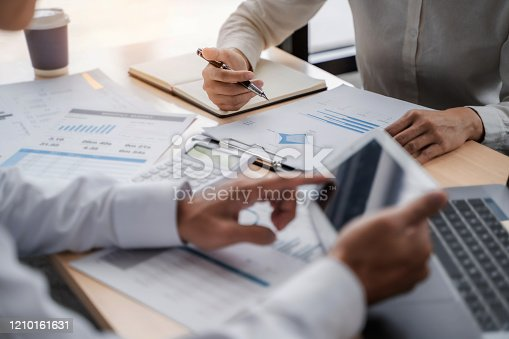 1068752548 istock photo Business sales consultant discussing in data documents at modern office. 1210161631