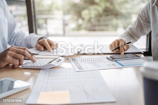 1068752548 istock photo Business sales consultant discussing in data documents at modern office. 1210161639