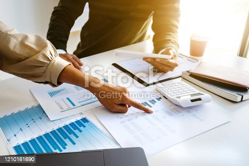 1068752548 istock photo Business sales consultant discussing in data documents at modern office. 1210161690