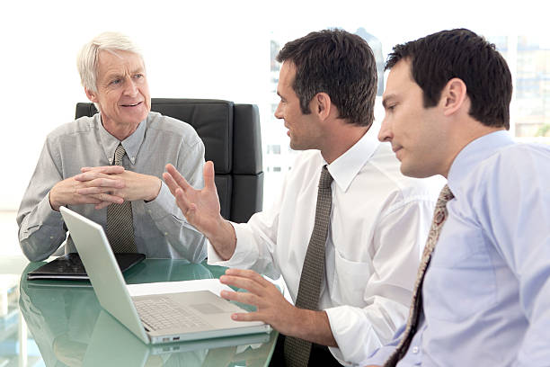 Business sales team meeting with CEO stock photo