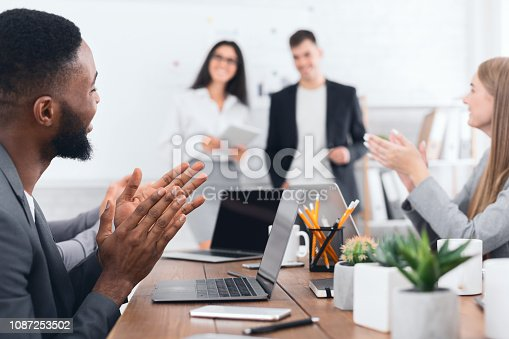1087253494 istock photo Business seminar. Colleagues clapping hands to speakers 1087253502