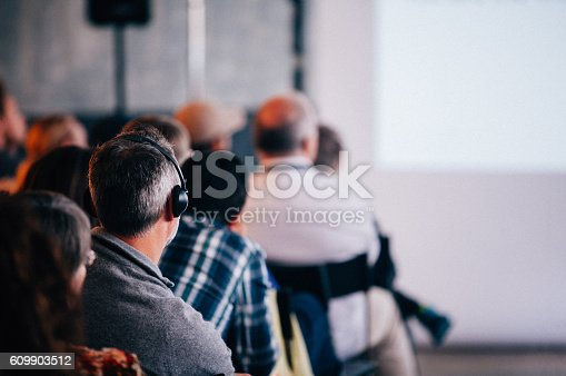 istock Business Seminar Conference with Translation of Headphone 609903512