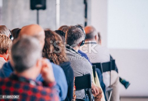 istock Business Seminar Conference with Translation of Headphone 614852062