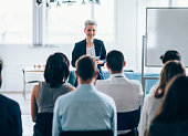Businesswoman leading a training class for professionals