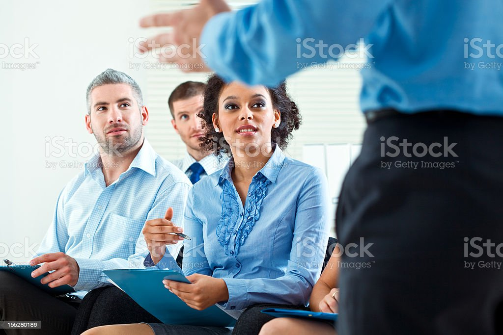 Business seminar Group of business people during business seminar, listening to presentation. 30-34 Years Stock Photo