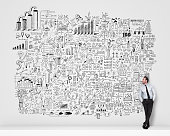Businessman standing look at drawing business planning.