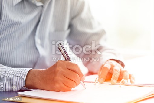 istock Business senior boss sign contract closeup hand write on paper report with luxury pen 1031873332