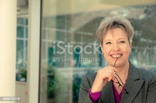 981750034 istock photo Business:  Senior businesswoman in modern office lobby. Glasses. 466570418