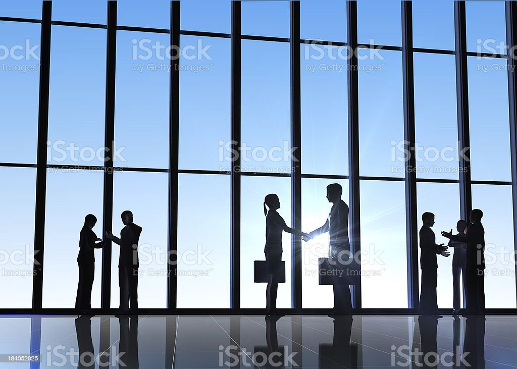 Business shake hand silhouettes royalty-free stock photo