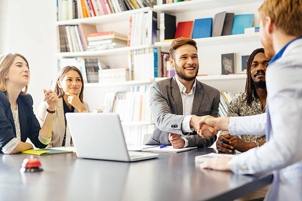 Business shaking hand with a client stock photo