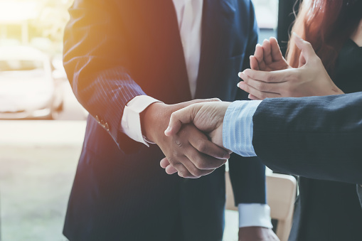istock Business shaking hands. Business executives to congratulate the joint. 908692790